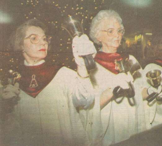 """Calder Baptist Church bell ringers Vicki Price, left, and Cathy Arrington perform recently. The group will play for the Holiday Fantasy."" This is from an article about the Beaumont Christmas Parade. File photo Dec. 15, 1989"
