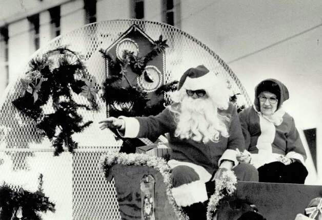 Santa (George Smith) and Mrs. Claus (Goldie Longsworth) from Hotel Beaumont wave to revelers at the Beaumont Christmas Parade. File photo Dec. 14, 1986