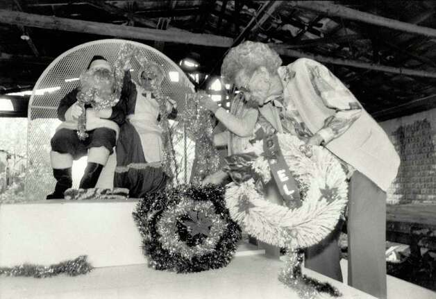 """Sally Rice helps other Hotel Beaumont residents, including Mr. and Mrs. Claus, prepare their float entry for Beaumont's Christmas Parade."" File photo Nov. 29, 1985"