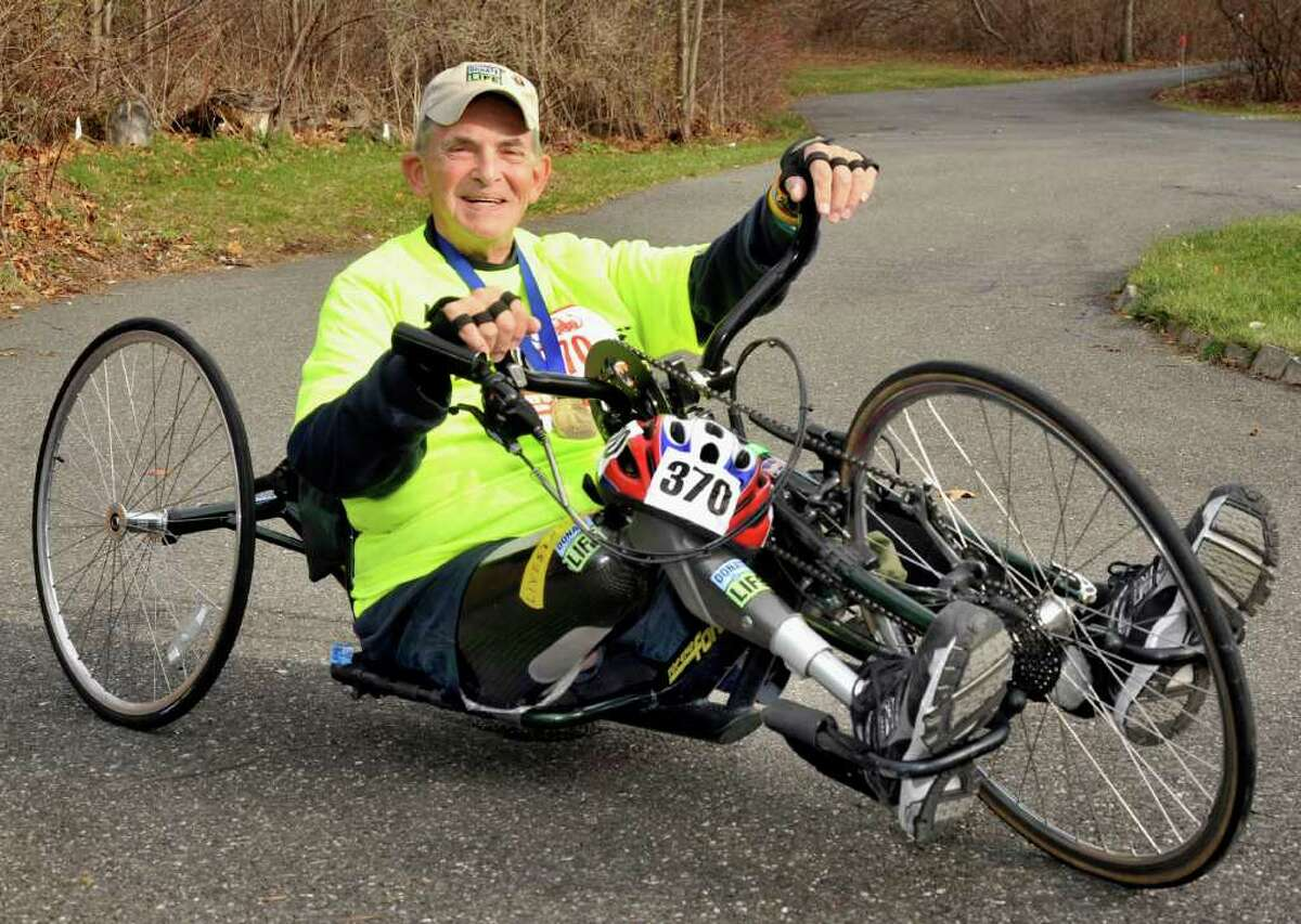 Tony Allegretti, 67, who is an amputee and liver transplant recipient, rides the hand -powered bicycle he used in this year's New York City Marathon outside his New Milford home, Friday, Dec. 3, 2010.