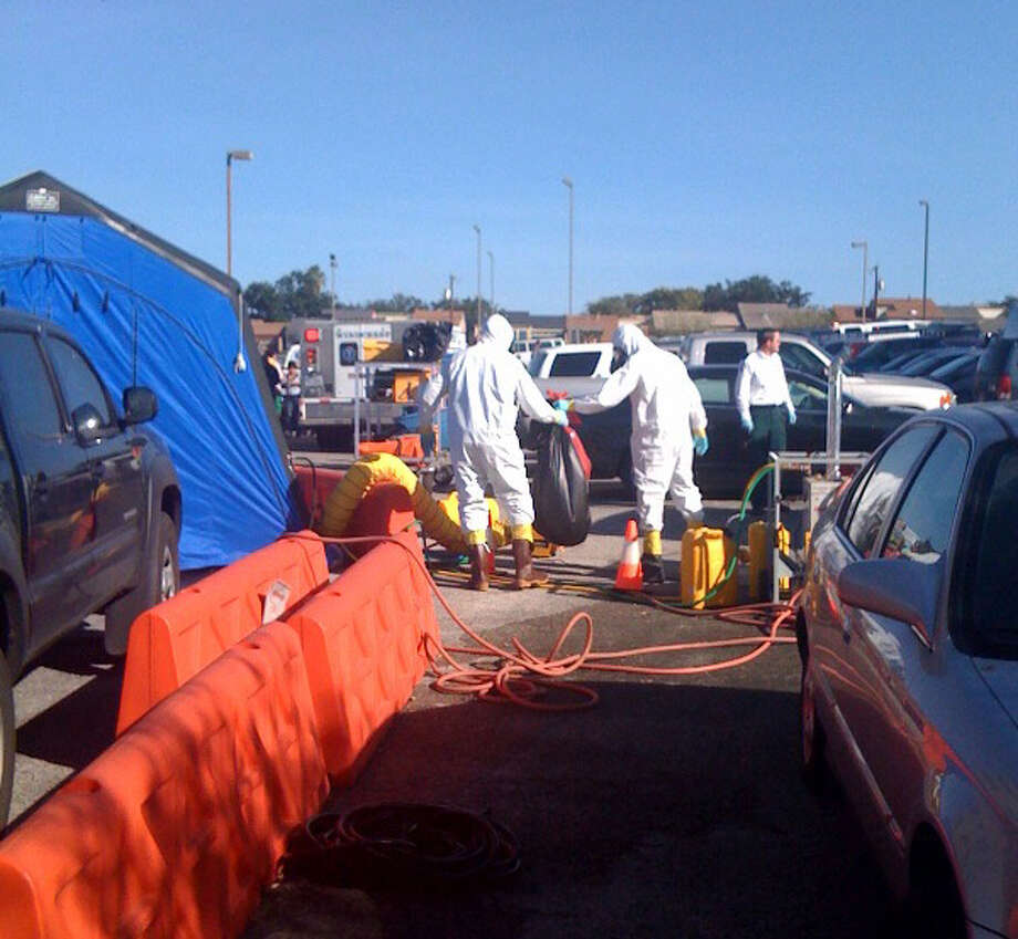 A hazardous materials team investigates an office building.