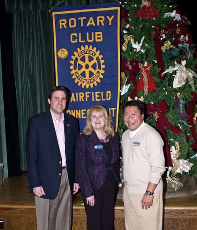 Pictured is Scott McCain of the Fairfield Rotary Foundation, Debra Greenwood for the Center for Women and Families, and Tony Hwang, Fairfield Rotarian and State Representative. The Fairfield Rotary Club recently donated $1,250 to the Center for Women and Families to assist with a satellite location in Fairfield. Photo: Kirk Lang / Fairfield Citizen