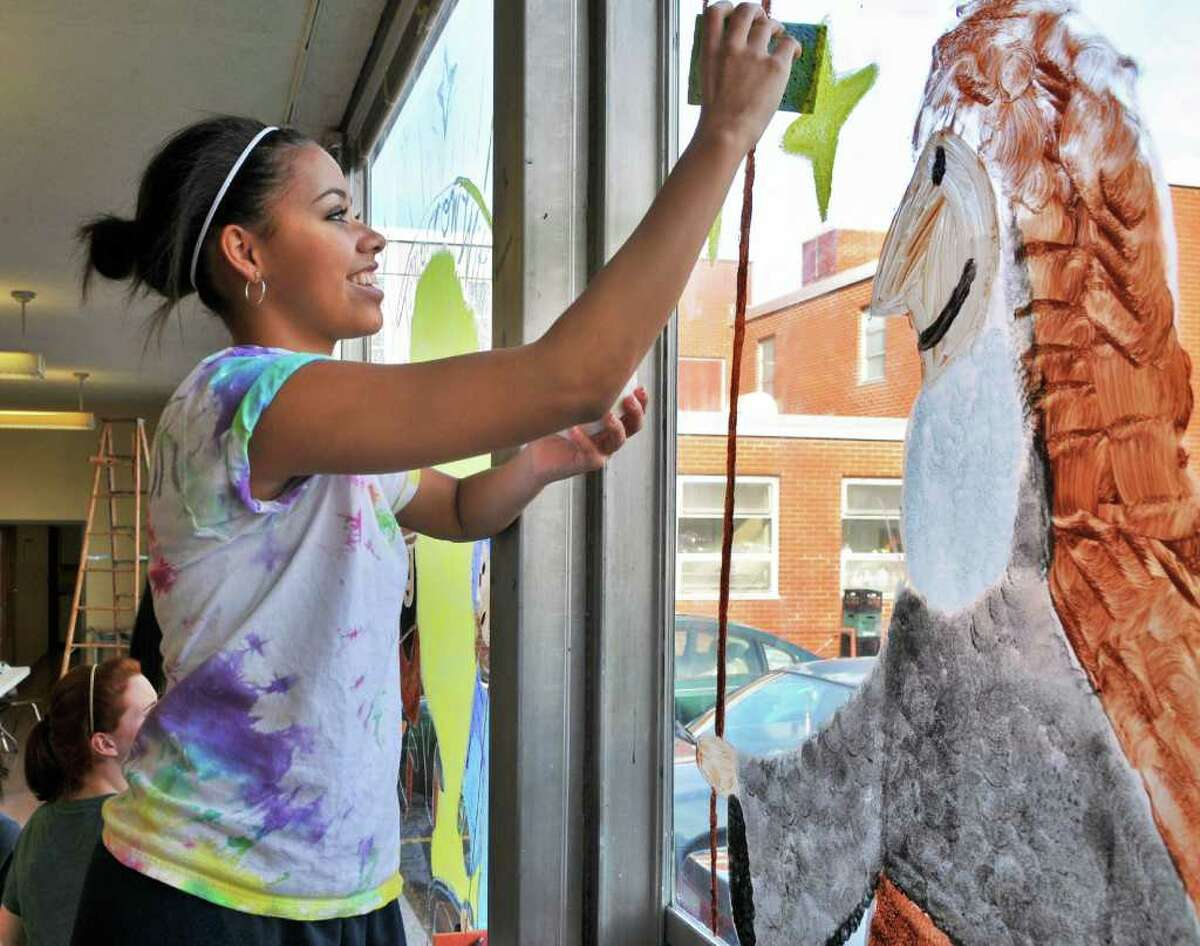 Academy of the Holy Names upper class student Dominique Ryan paints a holiday scene on a school window during the school's annual holiday class competition Friday morning December 3, 2010. (John Carl D'Annibale / Times Union)