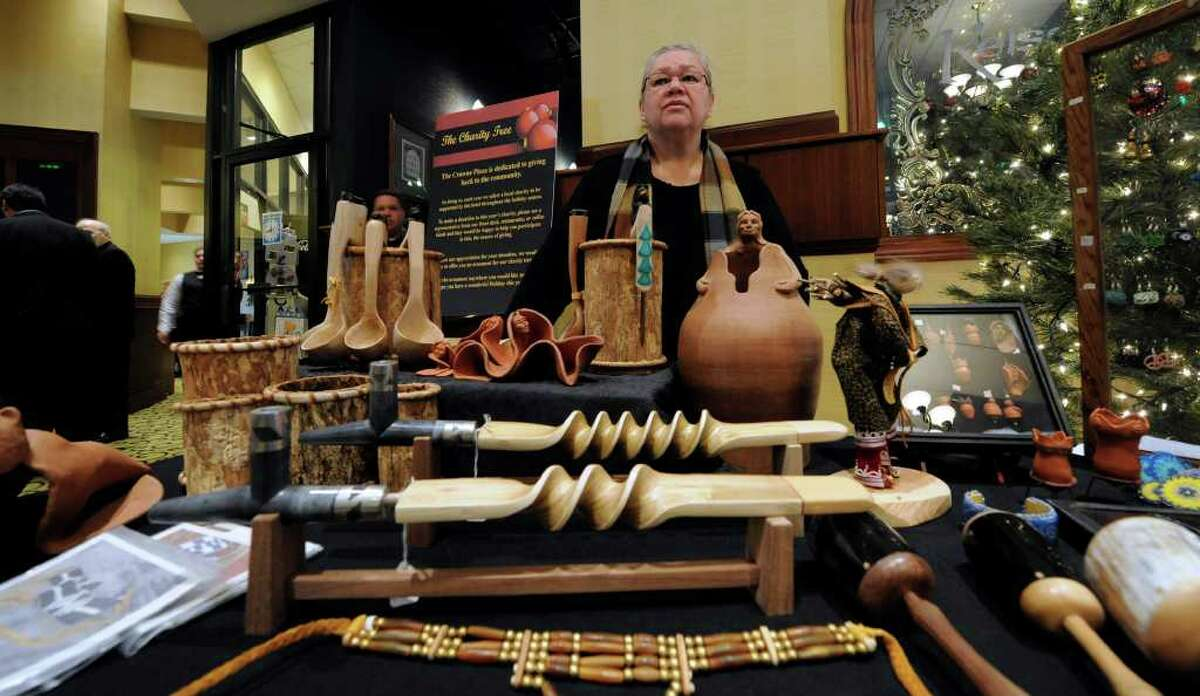 Tina Chrisjohn-Wyant of the Oneida Nation - Wolf Clan of Red Hook shows off Native American crafts at the Crowne Plaza in Albany on December 3, 2010, as part of the promotion of the Rock, Rattle and Drum Pow Wow that will be part of this year's New Year's Eve Celebration in Albany. (Skip Dickstein / Times Union)