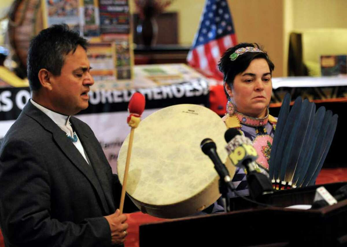 Fidel Moreno and Crystal Marion participate in an Honor Song at the Crowne Plaza in Albany on December 3, 2010, as part of the promotion of the Rock, Rattle and Drum Pow Wow that will be part of this year's New Year's Eve Celebration in Albany. (Skip Dickstein / Times Union)