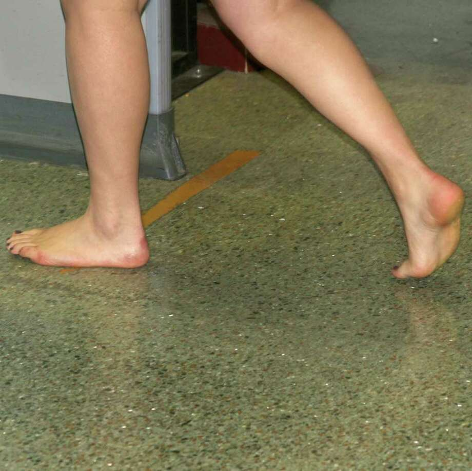 : Bare feet on a dirty floor, a common scene at San Antonio International Airport security checkpoints. Photograph by Forrest M. Mims III. Photo: FORREST M MIMS 111