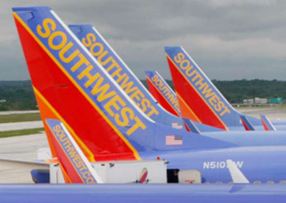 Southwest reported a small third-quarter loss and said there's no rebound in sight for business travel.