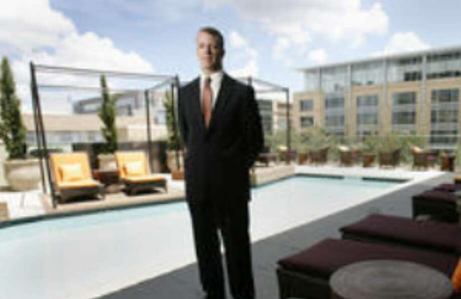 Ryan Gullion, general manager of Hotel Sorella in Houston, stands in the bar-pool area on the second floor.