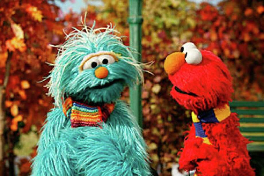 "This photo released by the Sesame Workshop shows Rosita, left, and Elmo in a scene from""TLC II Military Outreach Project,"" directed by Kevin Clash."