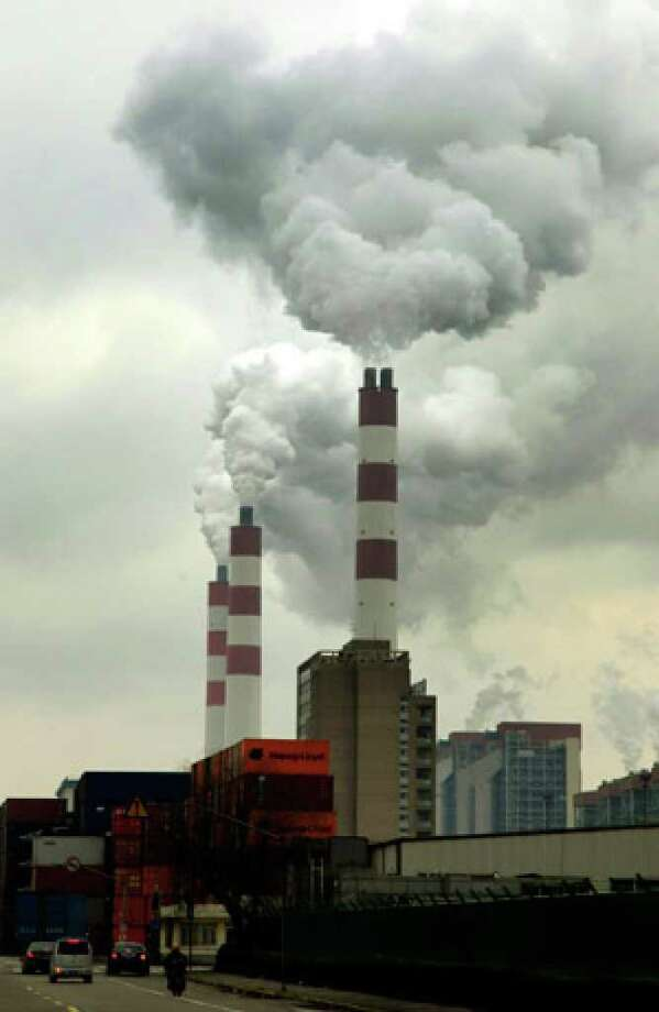 Factory chimneys pour out smoke in Shanghai. Despite a global economic slump, worldwide carbon dioxide pollution jumped 2 percent last year, most of it from China, new figures show.