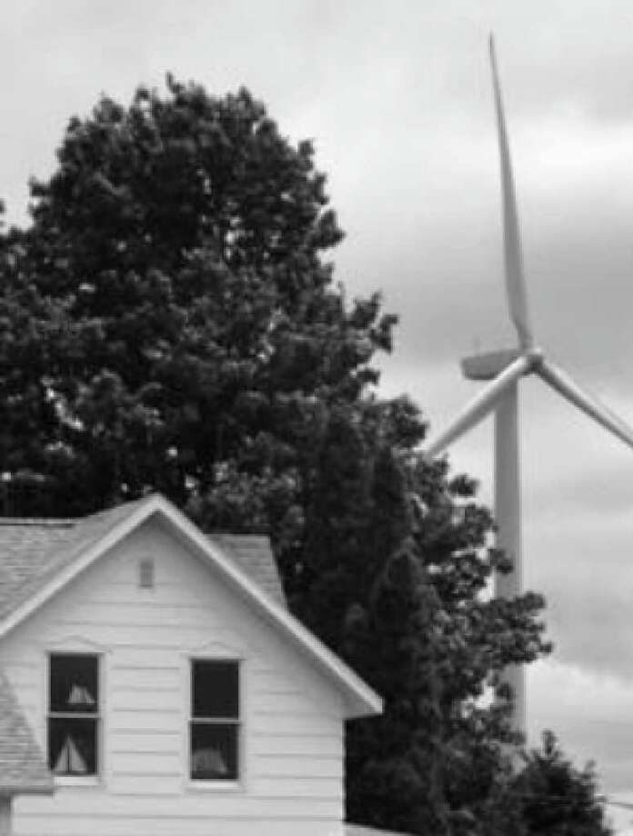 A home is situated near a wind turbine near Ubly, Mich.