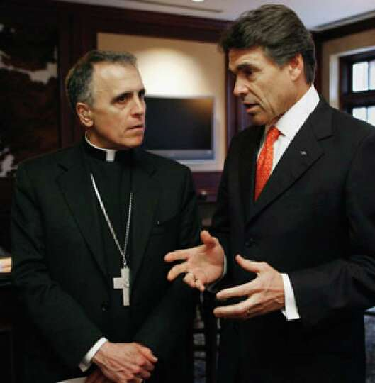 Cardinal Daniel DiNardo talks with Gov. Rick Perry before a luncheon the governor hosted in DiNardo'