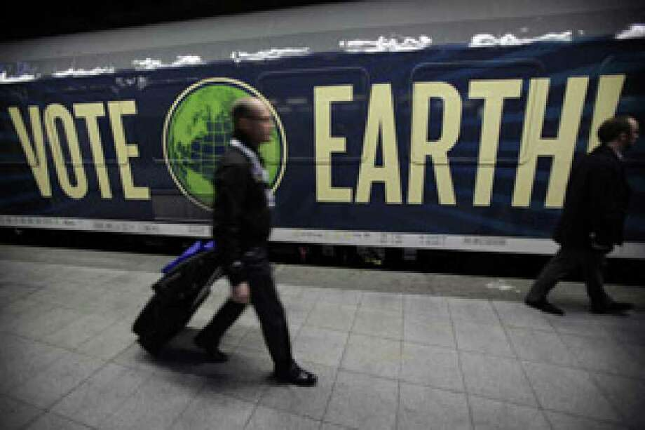 Travelers arrive to board the Climate Express from Brussels to Copenhagen for the climate summit on Monday.