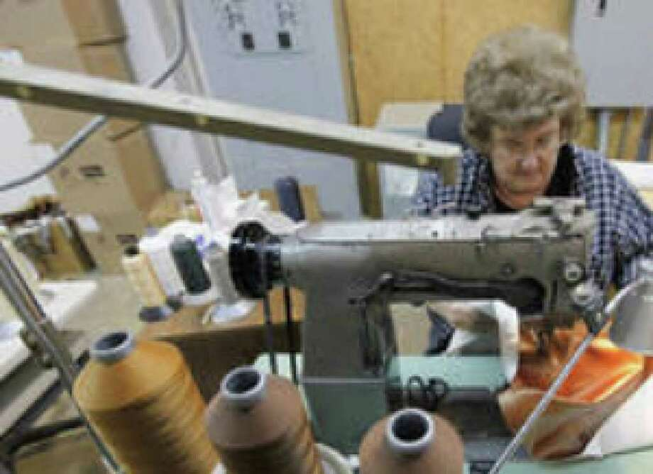 Vivian Bare sews at Legacy Furniture Group's plant in Conover, N.C. U.S. job losses are expected to rise until around the middle of 2010.