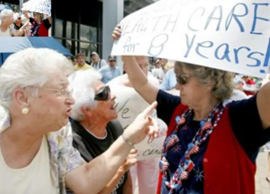Gwen LeBlanc (left) and Beverly Baudoin (center) argue with Audrey George about her sign during a rally against government-run health care Saturday, Aug. 22, in Houma, La. LeBlanc and Baudoin disagreed with George's sign that said the government ignored health care the past eight years.