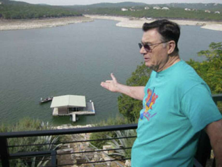 Ray Gay, who pumps water for his Village of Volente home from Lake Travis, says he'd rather move than continue if environmental officials allow treated sewage to be dumped into Sandy Creek, shown in the background, which empties into the lake.