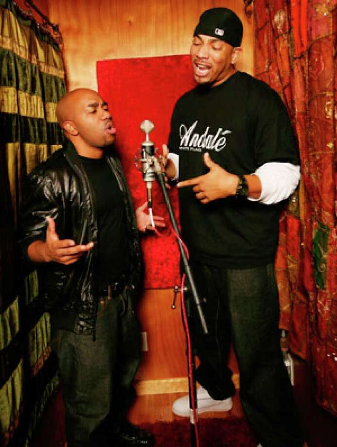 "Sean Simmonds (left) and Trey Williams perform in a studio in Harvest, Ala. Simmonds co-founded Xist (pronounced ""exist"") Worldwide Record Label, and Williams is a gospel rapper starring in Xist's film ""Stand."""