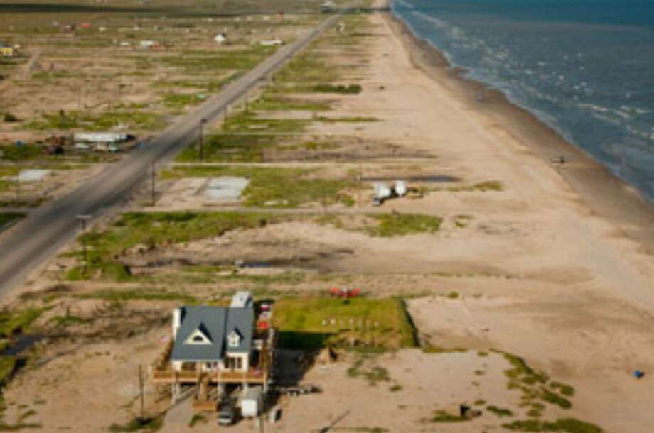 NOW: Much of the Bolivar Peninsula community of Gilchrist hasn't been redeveloped nearly a year after the storm.