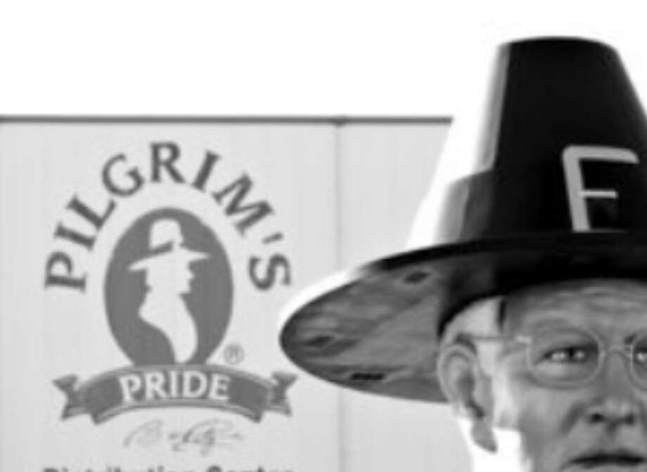 "A statue of Pilgrim's Pride founder Lonnie ""Bo"" Pilgrim marks the distribution center near Pittsburg. He said the JBS deal marks a new beginning for the company as it emerges from bankruptcy protection."