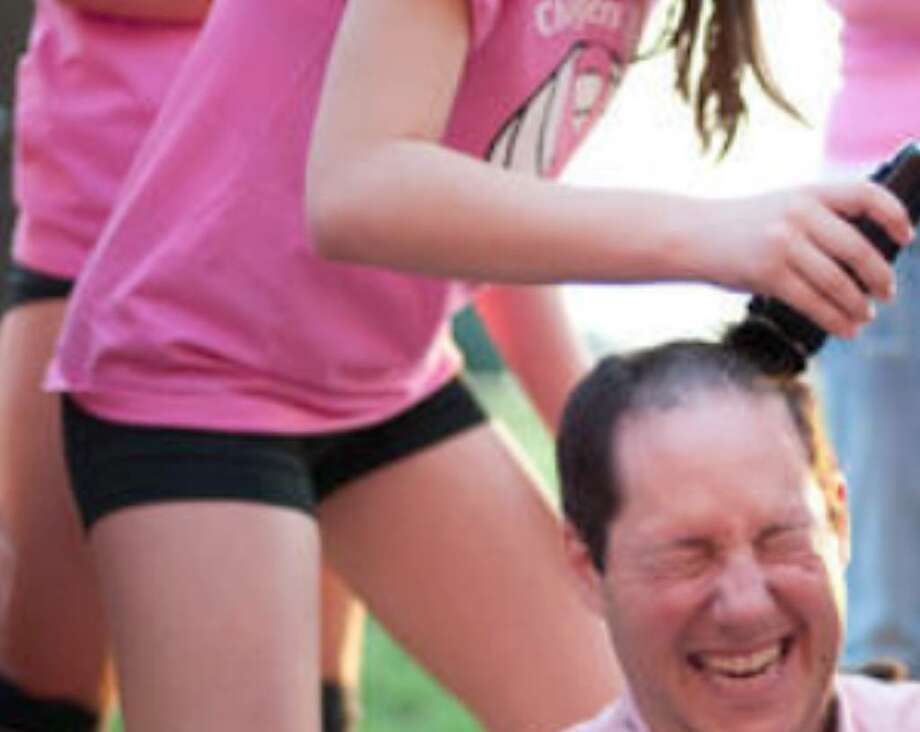 "Brad Beldon, father of Churchill freshman volleyball player Brittany Beldon, gets his head shaved as part of the high school's ""Dig for the Cure"" fund-raiser for the Susan G. Komen Breast Cancer Foundation."