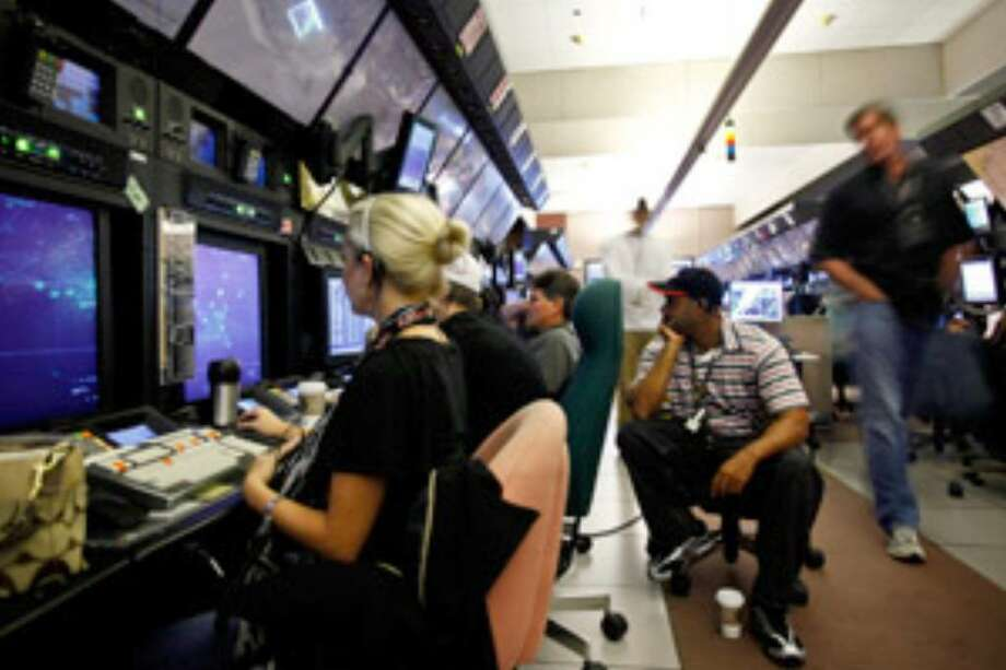 The inside of an air traffic control tower is also high on airline buff's want to see list. Here, FAA air traffic controllers watch radar scopes at Bush Intercontinental Airport in Houston.