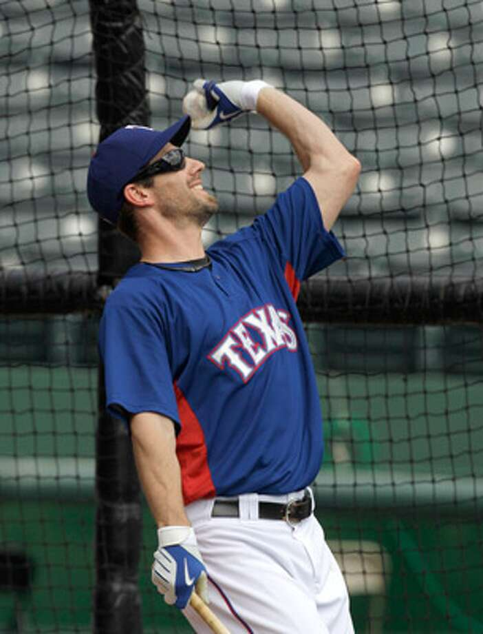 Texas Rangers starting pitcher Cliff Lee tosses a ball after taking a few swings during a team batting practice Sunday in Arlington. Game 1 of the World Series is on Wednesday.