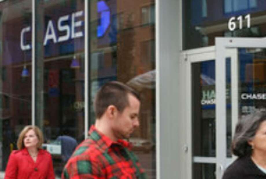 This Chase Bank in New York may be hiring, but first-time claims for jobless benefits increased more than expected last week, signaling that many employers are reluctant to hire.