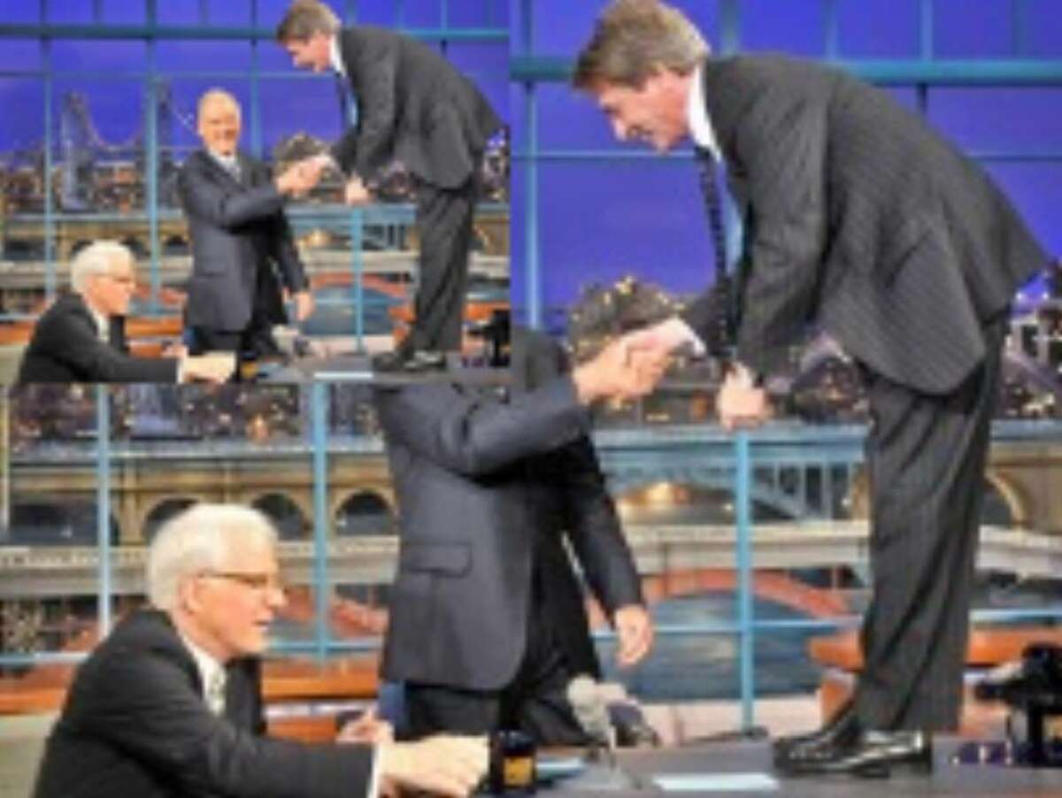 Steve Martin is seated as Martin Short shakes hands with host David Letterman during a taping of 'Late Show with David Letterman' on Monday.