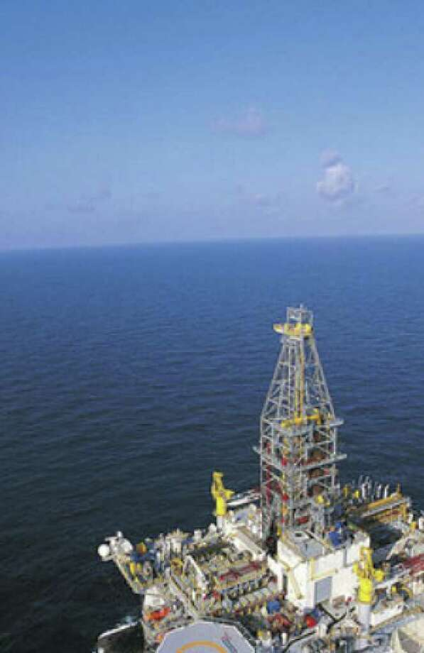 A deep-water rig operates in the Gulf of Mexico. More than half the volume of U.S. oil and gas discovered in 2009 is in an outer rim of the gulf between Texas and Louisiana.