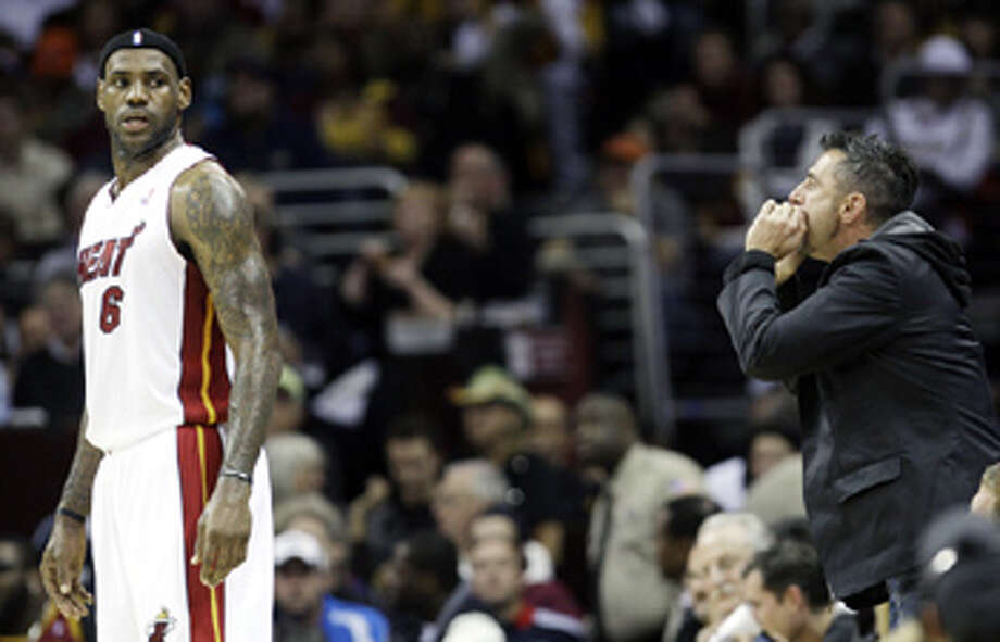 A fan yells at Heat forward LeBron James during the first quarter of a 118-90 road victory over the Cleveland Cavaliers on Thursday.