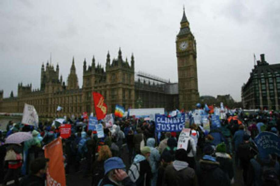 Demonstrators gather around Parliament in London, calling for action on climate change at a U.N. conference in Copenhagen. Thousands also demonstrated in other European cities.