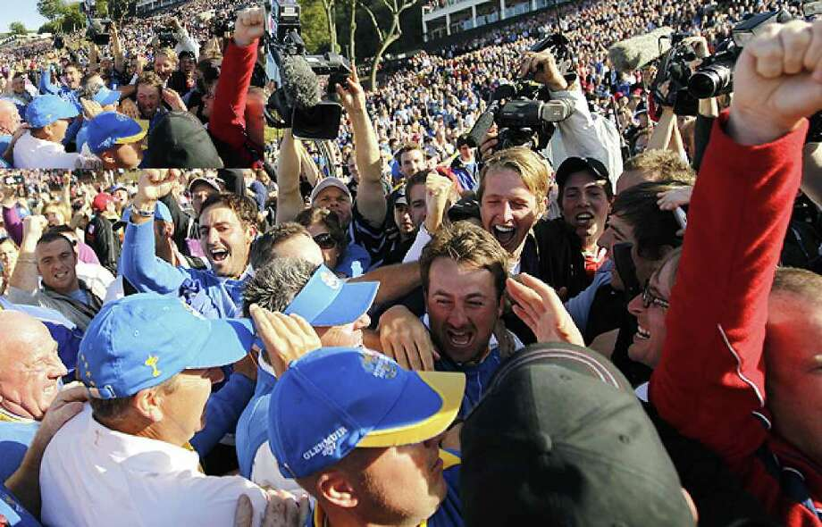 Europe's Graeme McDowell (center) celebrates with team members and the crowd after Europe won the 2010 Ryder Cup golf tournament at the Celtic Manor Resort in Newport, Wales on Oct.  4.