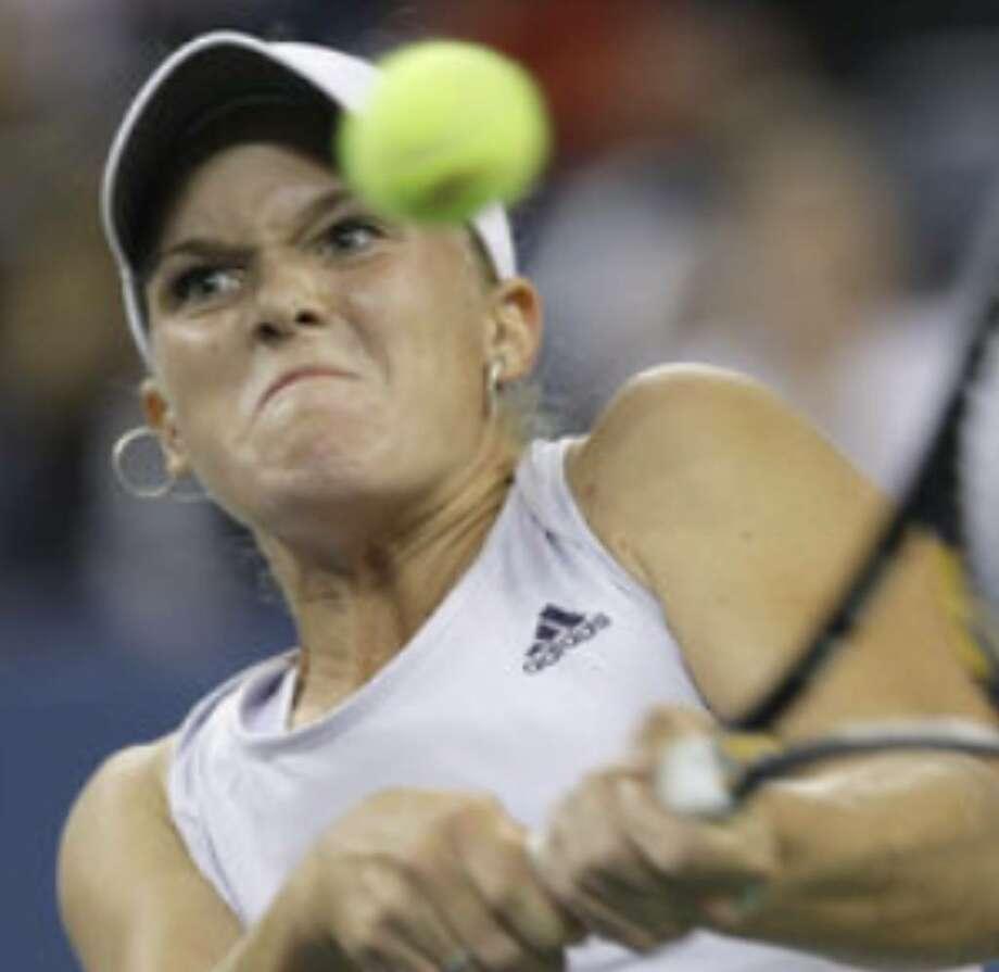 Melanie Oudin returns a shot to Caroline Wozniacki during their U.S. Open quarterfinal match Wednesday.