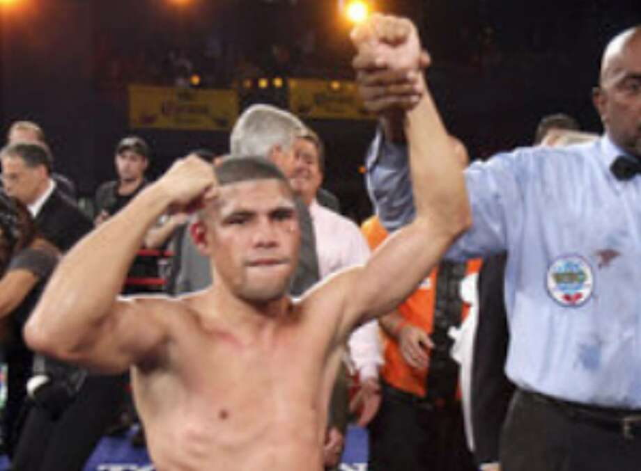 Juan Manuel Lopez of Puerto Rico acknowledges his win after defeating Rogers Mtagwa during a WBO Super Bantamweight Title fight Saturday, Oct. 10, in New York.
