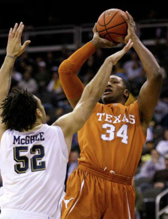 Texas' Dexter Pittman shoots over Pittsburgh's Gary McGhee during the first half Tuesday night.