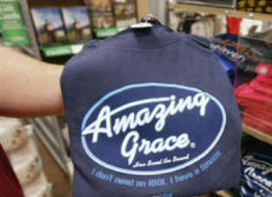"This T-shirt parody of the ""American Idol"" logo is one of many such products sold by Kerusso. CEO Vic Kennett says he gets some complaints from companies whose logos are parodied."