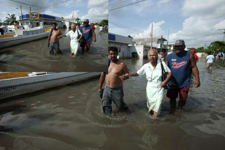 People walk on a flooded street in the aftermath of Hurricane Karl in the city of Veracruz, Mexico, Sept. 21. The remnants of Karl caused heavy rain and flooding in south-central portions of Mexico.