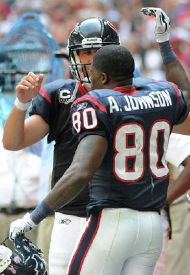 Houston Texans receiver Andre Johnson (80) and quarterback Matt Schaub celebrate their game-winning TD connection.
