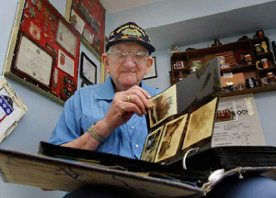 Bill Golden looks through a scrapbook of old photos at his home in St. Petersburg, Fla. Bill Golden survived more than 20 years in the Army and another 30 in law enforcement. He fell sick with colon cancer, and at 86, he has an artificial hip and arthritis in his knees. Golden still gives thanks, though, and researchers say that appreciative attitude can be good for you, too.