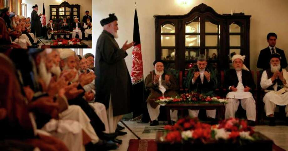 "Afghan President Hamid Karzai (fourth from right) prays with members of the Afghanistan's new peace council during the inaugural session in Kabul, Afghanistan, Thursday, Oct. 7, 2010. Calling the meeting a ""source of hope"" for the Afghan people, Karzai on Thursday hosted the inaugural session of the council set up to guide efforts to reconcile with the Taliban and other insurgent groups."