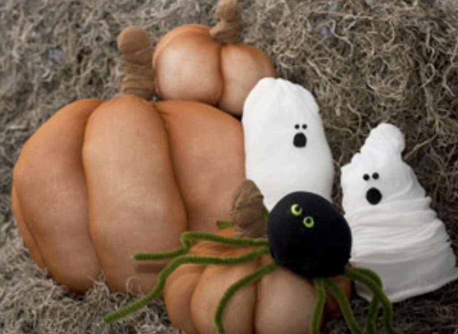 Pumpkins and other spooky crafts, made from old pantyhose, are an easy and fun project for your kids this Halloween season.