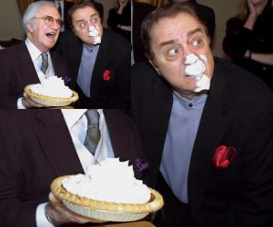 Comedian Soupy Sales (left) mugs for photographers after delivering his trademark pie-in-the-face to fellow comedian Pat Cooper during a party honoring his 75th birthday in this Jan. 8, 2001 file photo taken at the Friar's Club in New York. Sales, the rubber-faced comedian whose anything-for-a-chuckle career was built on 20,000 pies to the face and 5,000 live TV appearances across a half-century of laughs, died Thursday Oct. 22, 2009. He was 83.