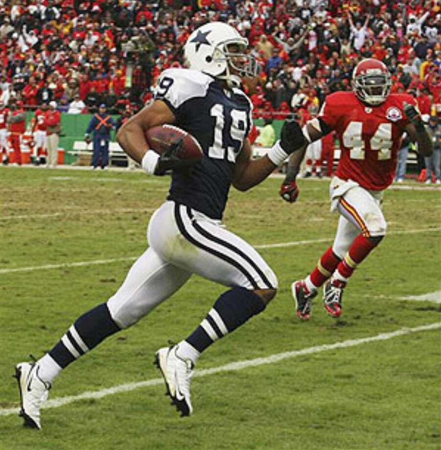 Cowboys wide receiver Miles Austin races past Chiefs safety Jarrad Page for a game-winning touchdown in overtime.