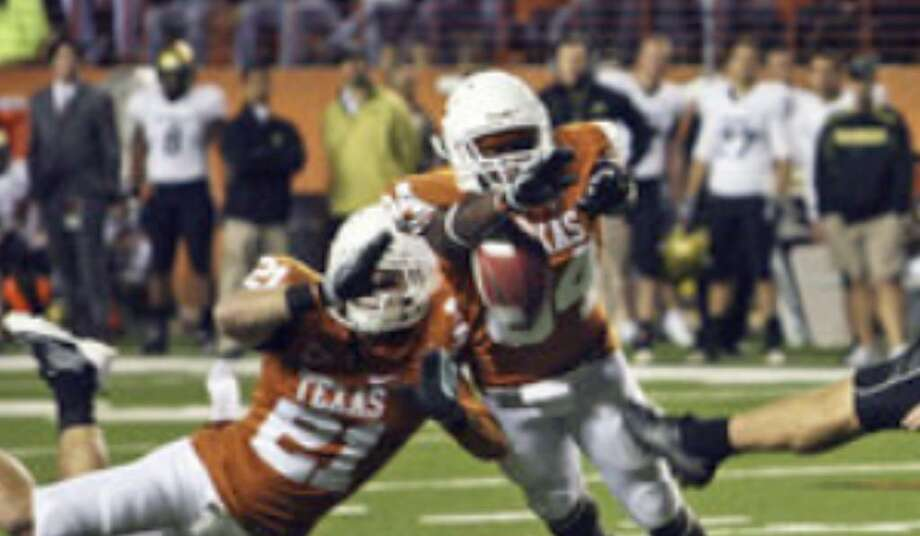 UT blocks a punt last weekend against Colorado. 'Defensively, I think we're playing as well as we ever have,' Texas coach Mack Brown said as the Longhorns prepare to take on the Sooners.