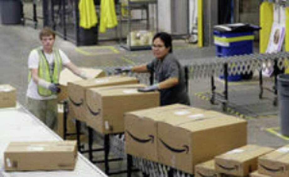 "Boxes set for shipping are separated at an Amazon.com warehouse in Goodyear, Ariz., last month. The company was one of the retailers stepping up discounts on ""Cyber Monday,"" the first day after the Thanksgiving weekend."