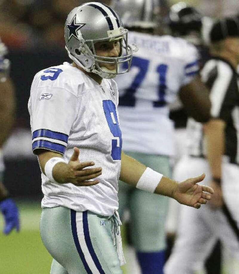 The Cowboys' Tony Romo shows frustration in Saturday's preseason loss at Houston.