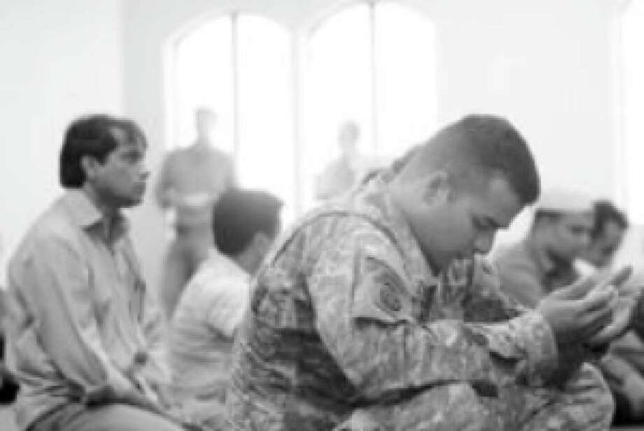 Sgt. Fahad Kamal of Houston  attends prayer services at the Islamic Community of Greater Killeen the day after the Fort Hood killings. While the vast majority of Americans realize most Muslims don't advocate violence, will they deal intelligently with a threat that arises from those who do?