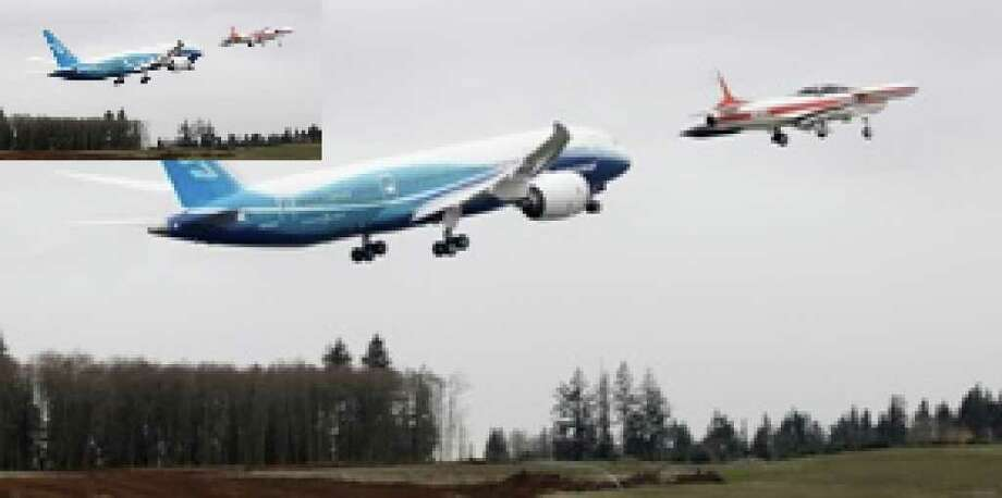 With a chase plane nearby, Boeing's 787 takes off from Paine Field in Everett, Wash., on its first flight. Boeing says the aircraft will be quieter, produce less pollution and use 20 percent less fuel than comparable planes.