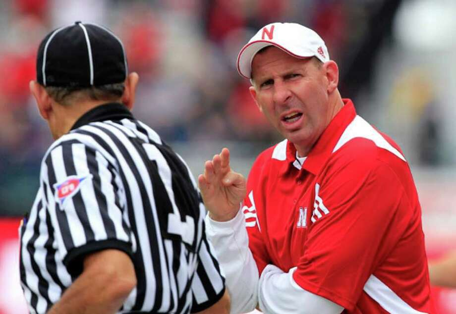 Nebraska coach Bo Pelini talks with an official during the Cornhuskers' 56-21 victory over Washington in September.