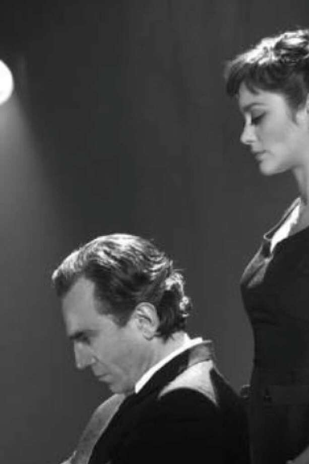 "Daniel Day-Lewis and Marion Cotillard portray Guido and Luisa Contini in ""Nine."""